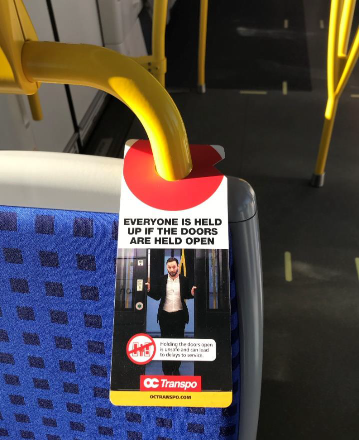 Paper hanger about door safety on the train.