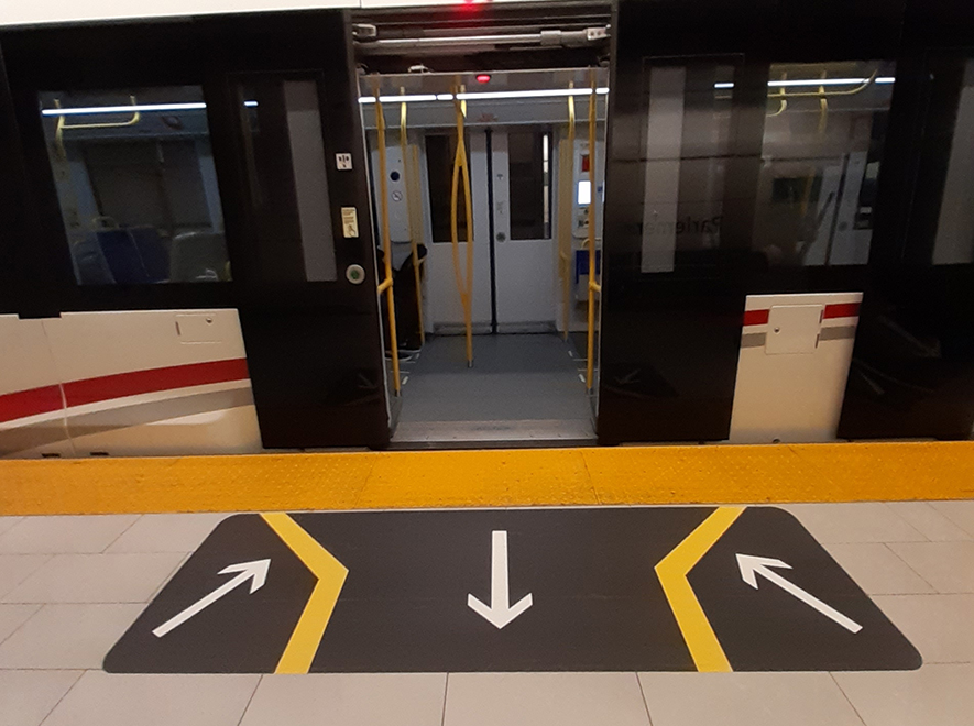Floor decals showing passengers where to stand when entering and exiting the train.