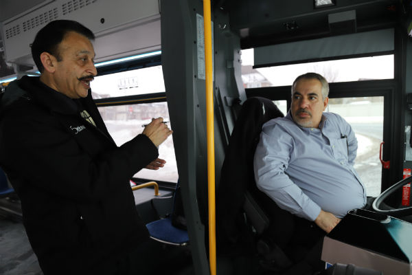 Transit Training Instructor Devinder Andotra and New Bus Operator Trainee Hamdan Othman.