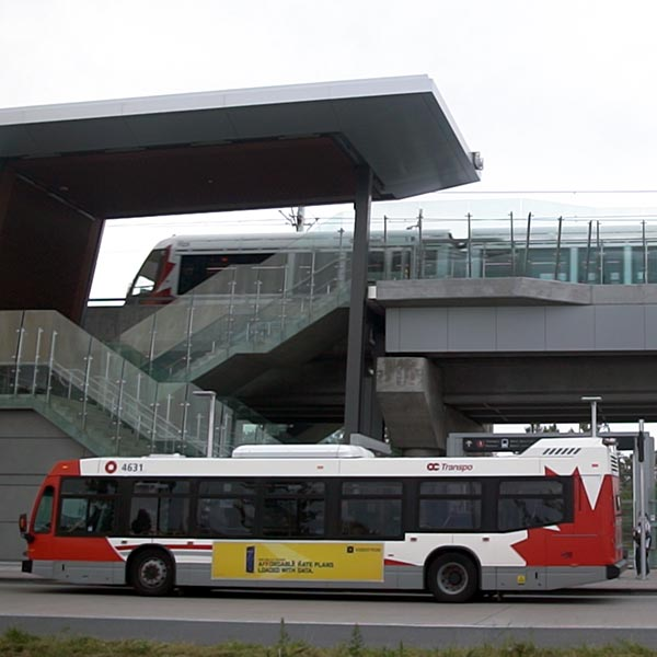Bus and O-Train at Hurdman Station.