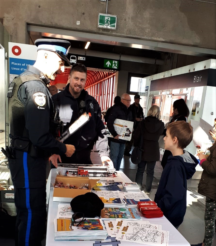 Special Constable at a booth speaking with passengers.