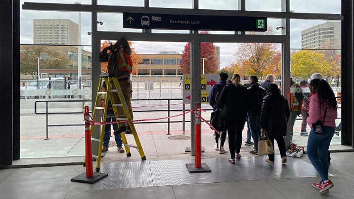 City staff removing doors at Tunney's Pasture Station.