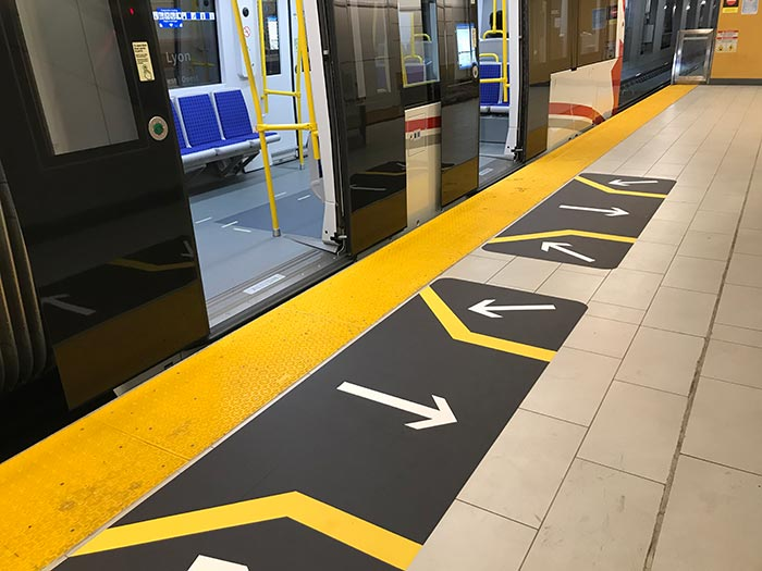 Floor decals showing passengers where to stand when entering and exiting the train. (alternate view)
