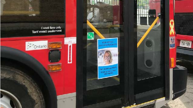 Mask awareness poster on front door of bus