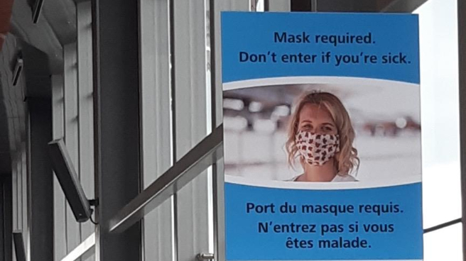Mask awareness signage in the station.