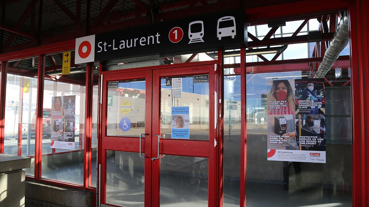 Signage related to mask requirements and other protective safety measures at the entrance of St-Laurent Station.