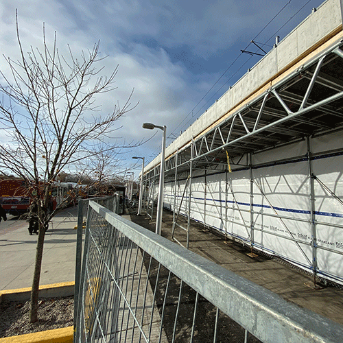Image of predestrian canopy installation at Hurdman
