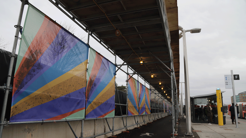 Photo of decorative mesh banners along the rear of the pedestrian canopy at Tunney's Pasture Station