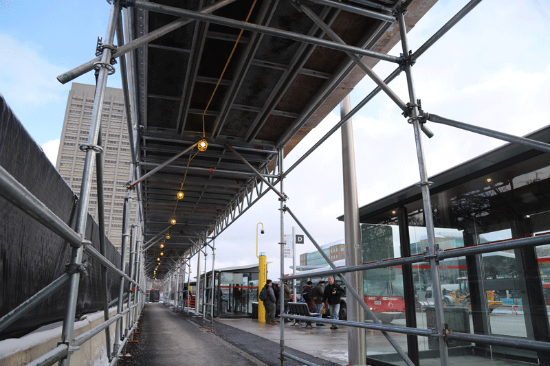Image of pedestrian canopy installation at Tunney's Pasture