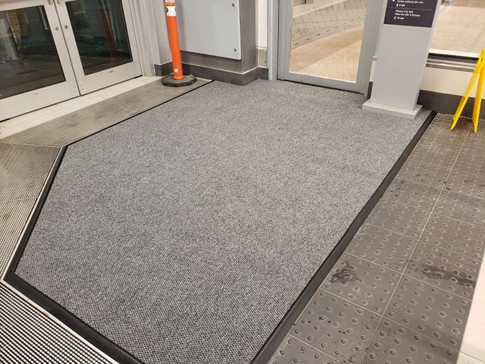 Floor mat at the entrance of Parliament Station.