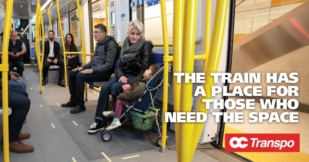 Woman with a child in a stroller seated in the Cooperative seating area. Image text: The train has a place for those who need the space.
