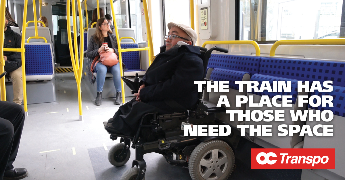A man in an electric wheelchair in the train's Cooperative seating section. Image text: The train has a place for those who need the space. Each car on O-Train Line 1 has four cooperative seating areas.