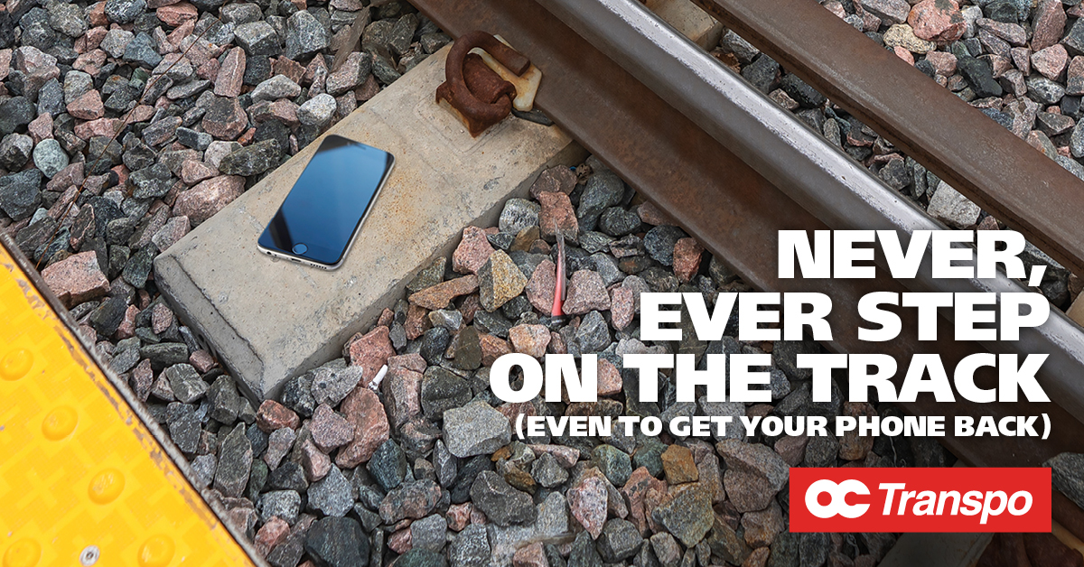 A phone on the tracks. Image text: Never ever step on the track, even to get your phone back. Ask an OC Transpo employee or use the emergency phone on the platform for help.