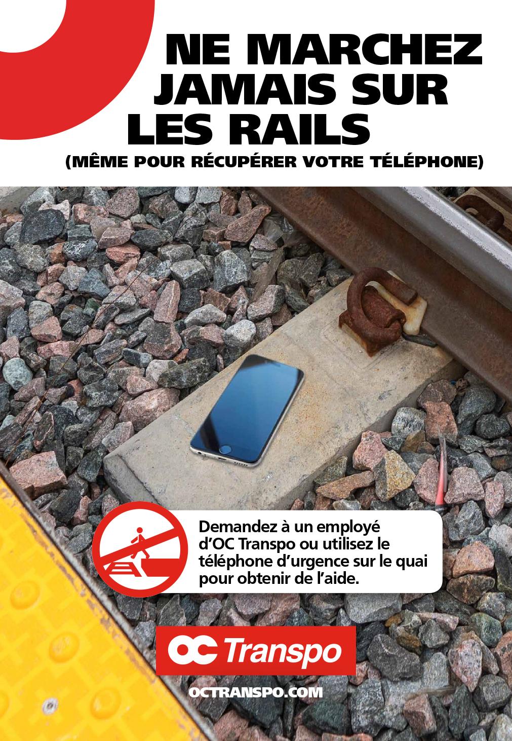 Un téléphone sur les rails. Texte sur l'image : Ne marchez jamais sur les rails (même pour récupérer votre téléphone)