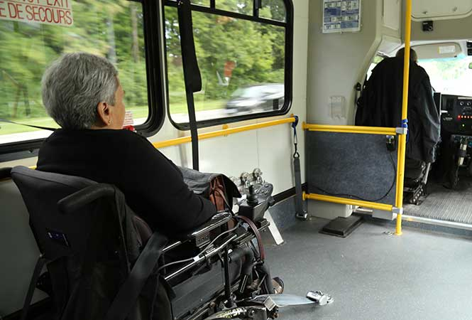 Para Transpo customer with a mobility device taking a trip in Para Transpo vehicle.
