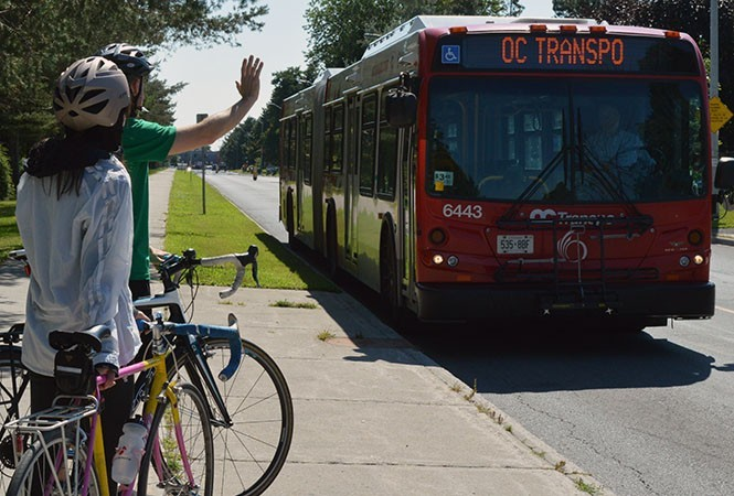 Cyclists signaling to a bus.